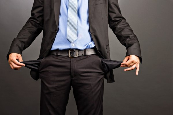 depositphotos 32411497 business man showing his empty pockets